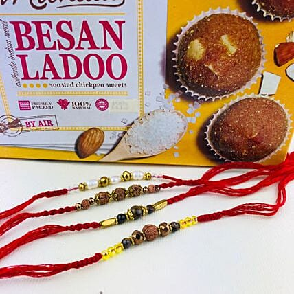 Super Four Rakhi Set With Besan Laddu: Send Devotional Rakhi to Australia