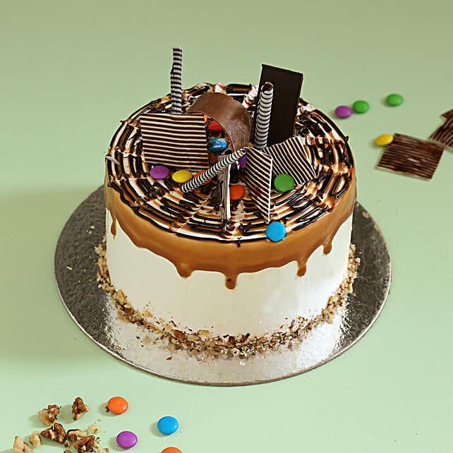 Gems Sprinkled Caramel Cake: