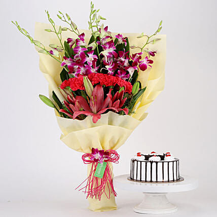 Pink & Purple Flowers & Black Forest Cake Combo: Send Carnations