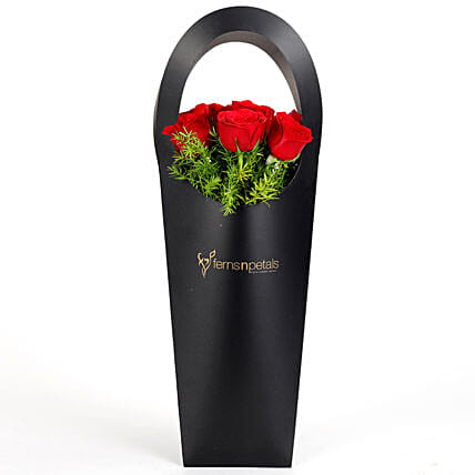 Red Roses in Stylish Black Sleeve: Flower Arrangements