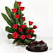Combo of cane basket arrangement of 15 red roses, draceane leaves and seasonal filler with 500 grams truffle cake