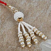 Send gifts to uk online same day gift delivery in uk ferns n petals white luma rakhi for bhabhi negle Choice Image