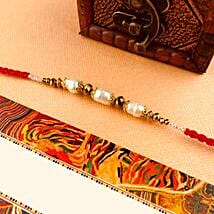 Send gifts to australia online gift delivery australia ferns n white beads rakhi negle Image collections